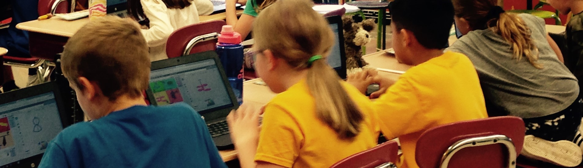 Students coding on Chrome books